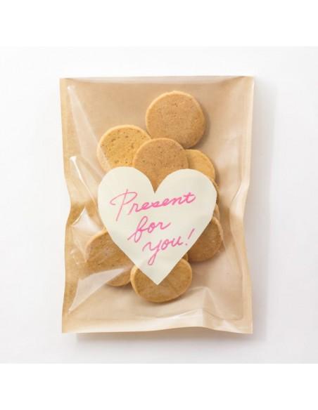 bustine clear faced bag chotto midori taglia M front print heart white vista con caramelle